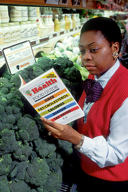 African American woman working in grocery store.