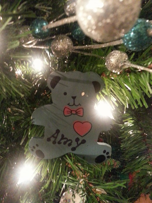 Blue Bear ornament made by my daughter.  I did not have any blue on my Christmas tree at the time, but I did after receiving that ornament and still do!  Looks like one of the poor bear's eyes has gotten damaged over the years. That can be fixed.