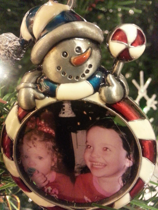 Photo ornament of both my granddaughters.  These are great and you can get the ornament at the Dollar Tree!  They have a variety of cute ones each year.
