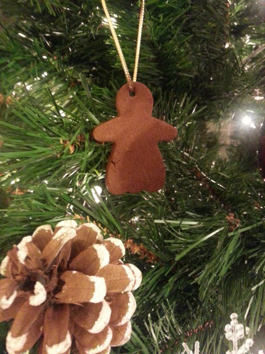Gingerbread cookie ornament made by my daughter when she was very young.  It is rock hard by now!