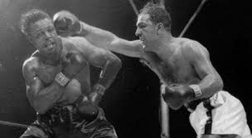 Rocky Marciano knocked out Archie Moore in the 9th round of his final fight and the last heavyweight title bout of his career.
