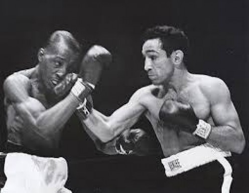 Sandy Saddler knocked out Willie Pep I'm four rounds to win the Featherweight world championship.