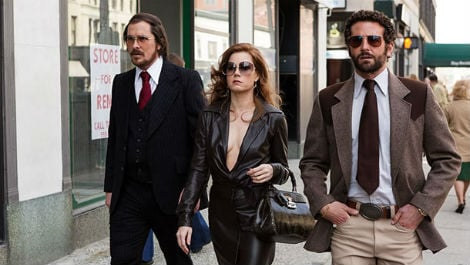 Christian Bale and Amy Adams play a pair of con artists who've been coerced into working with the FBI by an agent played by Bradley Cooper.