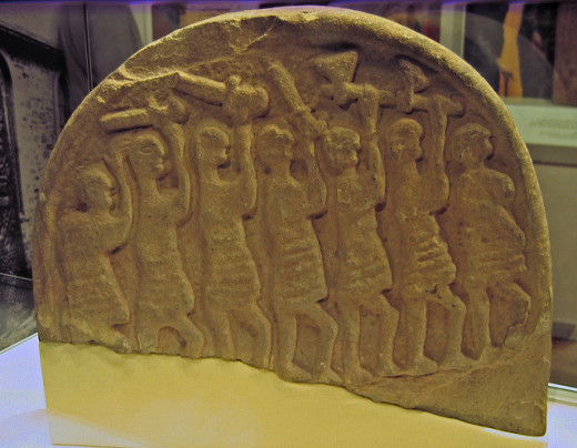 9th Century Lindisfarne grave marker, known as the Viking gravestone - shows a file of armed warriors on the march