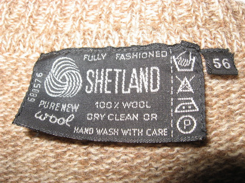 Label with care symbols on a wool sweater