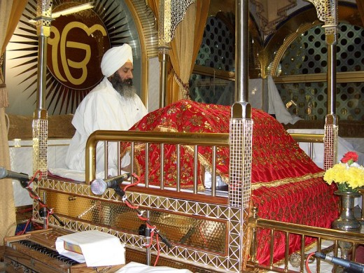 A Sikh man in attendance to the Sri Guru Granth Sahib, the Sikh Holy scripture