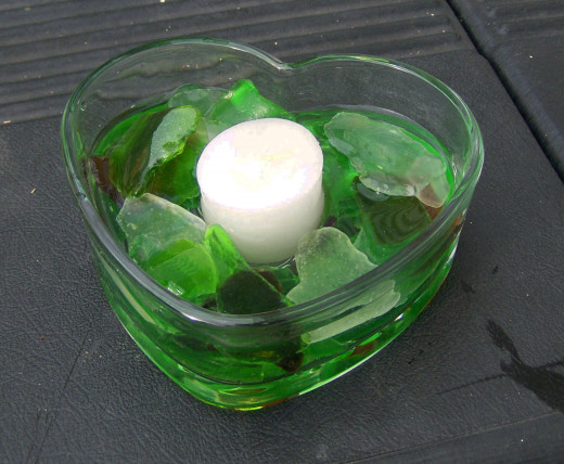 Green and white (with a dash of brown) themed candle holder.