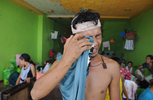 A resident who survived Typhoon Haiyan cries inside a stadium used as an evacuation center in Tacloban, Leyte province, central Philippines. (One of lucky survivor)