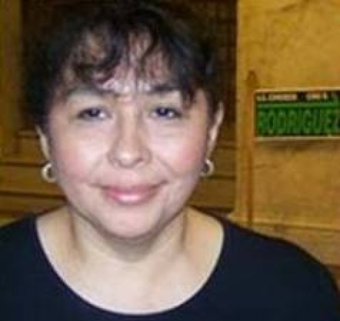 Sylvia Ruiz Mendelsohn, board president and paid campaign worker for County Commissioner Rodriguez.