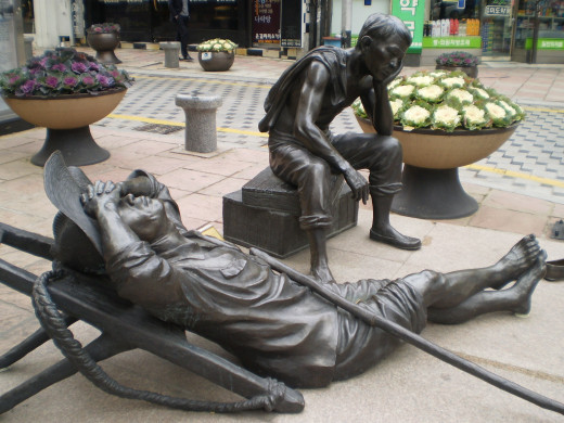 """Relaxation of a Father"" statue which expresses a father taking a rest, exhausted by a tough day's labor."