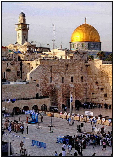 """""""Dome of the Rock"""" above and the wall below is the western wall, remains of the old temple. Notice Jews praying by hitting their head on to the wall"""