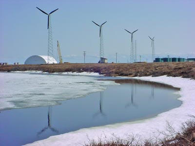 Energy from the wind is produced from wind turbines such as these in Alaska.
