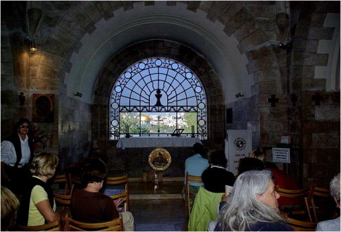 """Temple Mount and the Dome of the rock is seen through the Altar window of  """"Church of the tear drops"""""""
