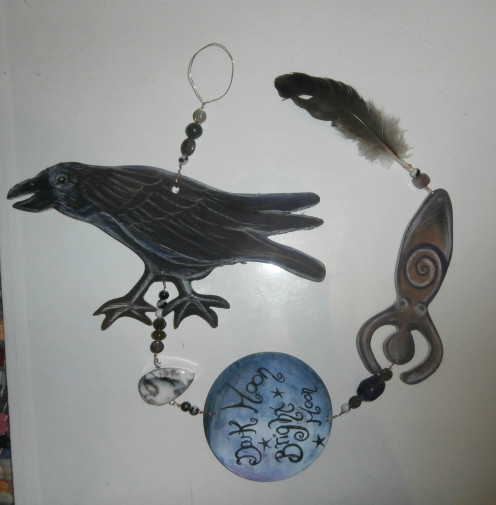 "This ""Dark Goddess"" hanger features a large focal raven, various gemstones (one seated in sterling), a moon with text, a Goddess and a crow feather found in the woods."