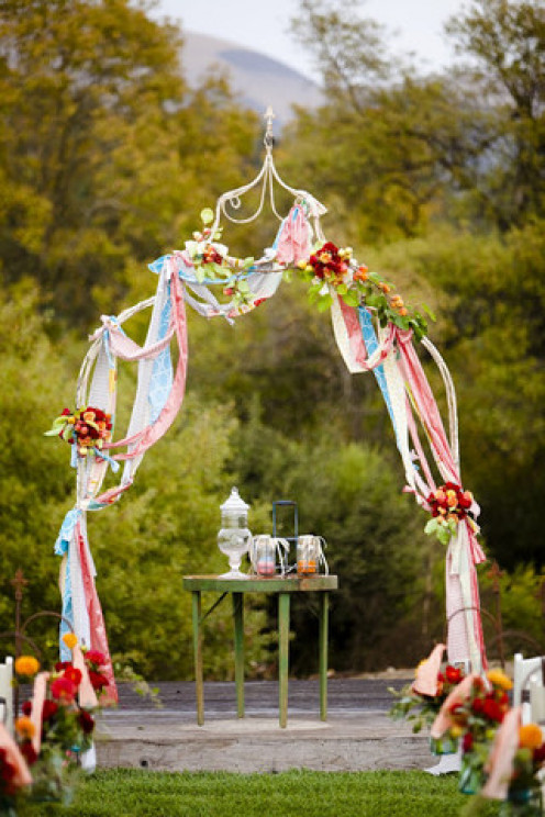 Add a touch of whimsy!  Use iron arches, and lots of different floral arrangements and color.