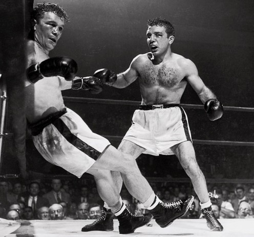 Jake LaMotta knocked out Laurent Dauthelle in the 15th and final round in defense of his Middleweight Championship.