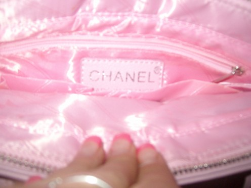The Chanel is stamped with silver on leather