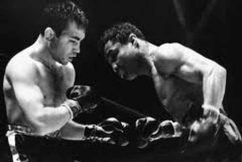 Barney Ross and Henry Armstrong, right, fought a competitive bout which was won by Armstrong.