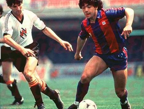 Maradona doing what he does best, taking on players
