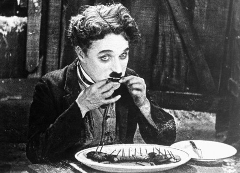 "Charlie Chaplin's character The Tramp eats his boot while dining alone in the silent film ""The Gold Rush"" (1925)"