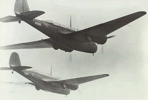 A pair of Dutch Model 166s over Malaya in 1942.  Note the large 'glass-house' canopy.