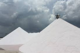 Huge mountains of salt wait transportation in a Mexican salt operation