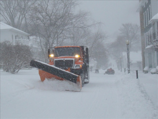Allowing snow plows to clear the road and not passing them will benefit all drivers.