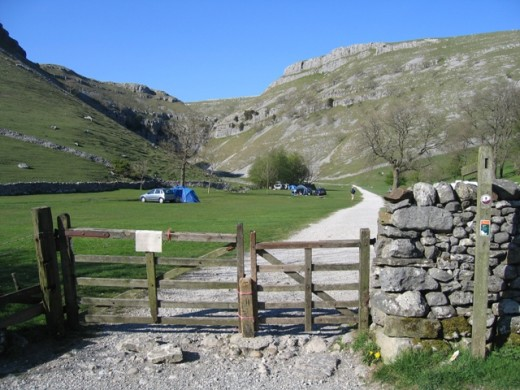 The Gordale Scar site seen from the farm road. Follow the stone track through the gate, to the...
