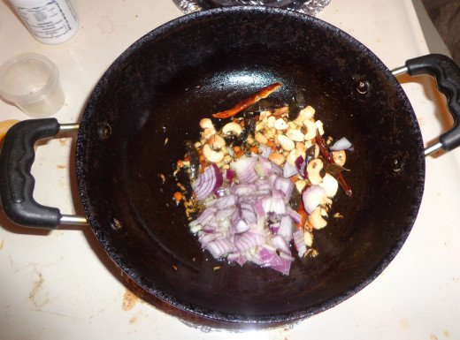 Onions are added for frying