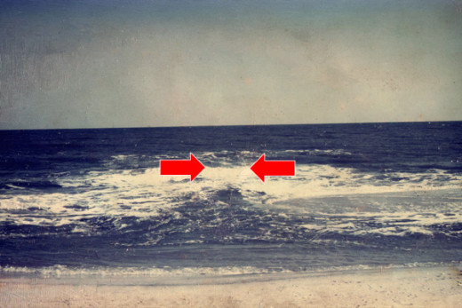 The location of a rip can be identified by experienced surfers and beach goers.
