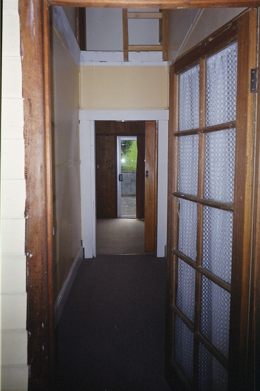 The front hallway after we took the ladder to the roof space away.