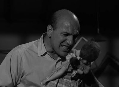 Telly Savalas as Erich Streator