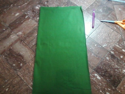 The fabric is folded vertically and ready to receive the pattern.