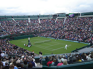 A tennis match at Wimbledon, the oldest and the most prestigious tennis tournament.