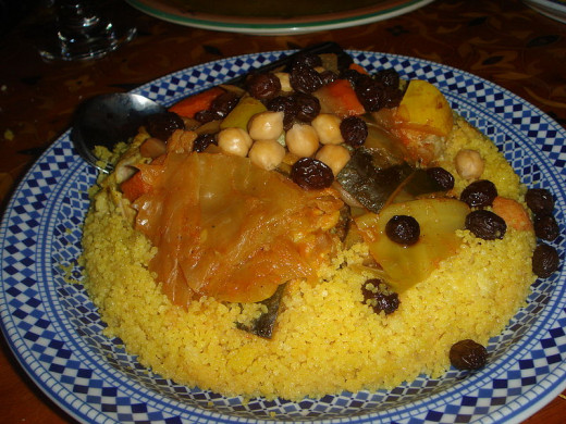 Moroccan Lamb tagine can be served with flat bread or over couscous with beans and lentils.