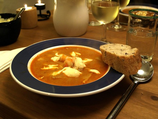 Bouillabaisse fish soup with crusty bread.