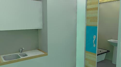 Edge of the kitchenette, storage cupboard and bathroom door
