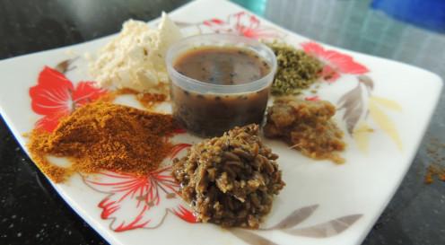 Clockwise: Turmeric powder,all purpose flour,Mouri masala powder,Ginger paste,Cumin Paste,Black Pepper Pate