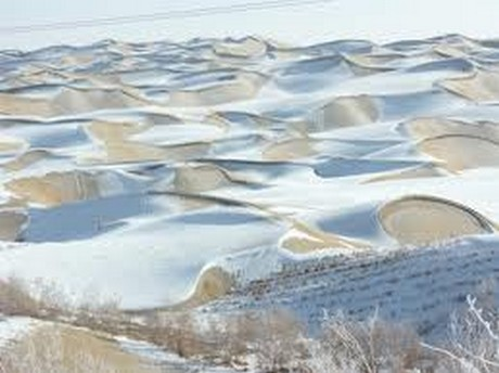 Snow on the sand dunes in Algeria indicate this is not a 100 Year Event but another example of the increase in the Earth's Wobble.