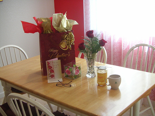 Setting up a romantic table with roses and gifts will help get your February 14th off to a good start!