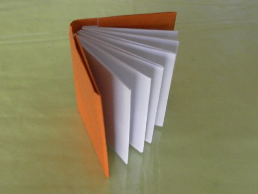 Gather all the pages together and arrange them into the book cover to make the origami book. Yay! An origami book!
