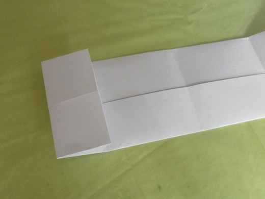 Fold the left edge to align with the first vertical line on the left.
