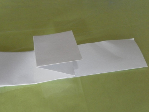 Continue folding the top flap in an accordion-like manner (one fold up, one fold down and so on).