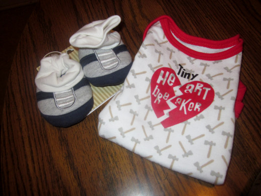 A cute onesie and booties or crib shoes are an extra to add to the survival kit, just to make it more fun to open.