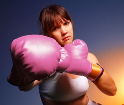 pink satin boxing gloves and girl fighting