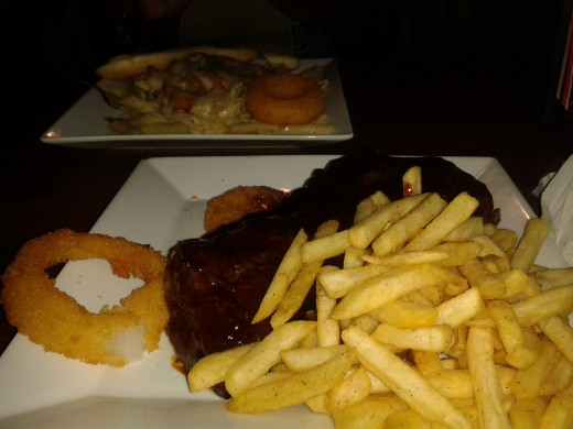 Baby back ribs, fries and onion rings, also an Italian pasta with chicken, Parmesan cheese etc.