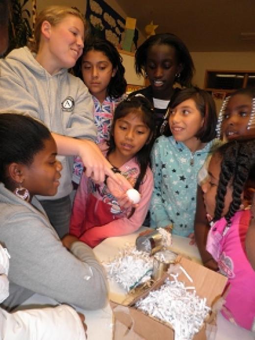 AmeriCorps volunteer working with children