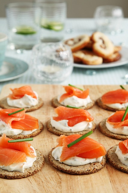 Serve salmon on crackers which can be prepared ahead of time.