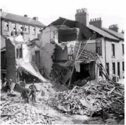 Bombs dropped from enemy aircraft then, later the 'Doodle Bugs' (V1 rockets) and later the more deadly V2s.  A great many homes were destroyed.