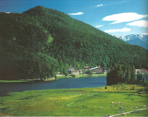 Lakes surrounded by mountains Arabella Alpenhotel in Spitzingsee in Germany.